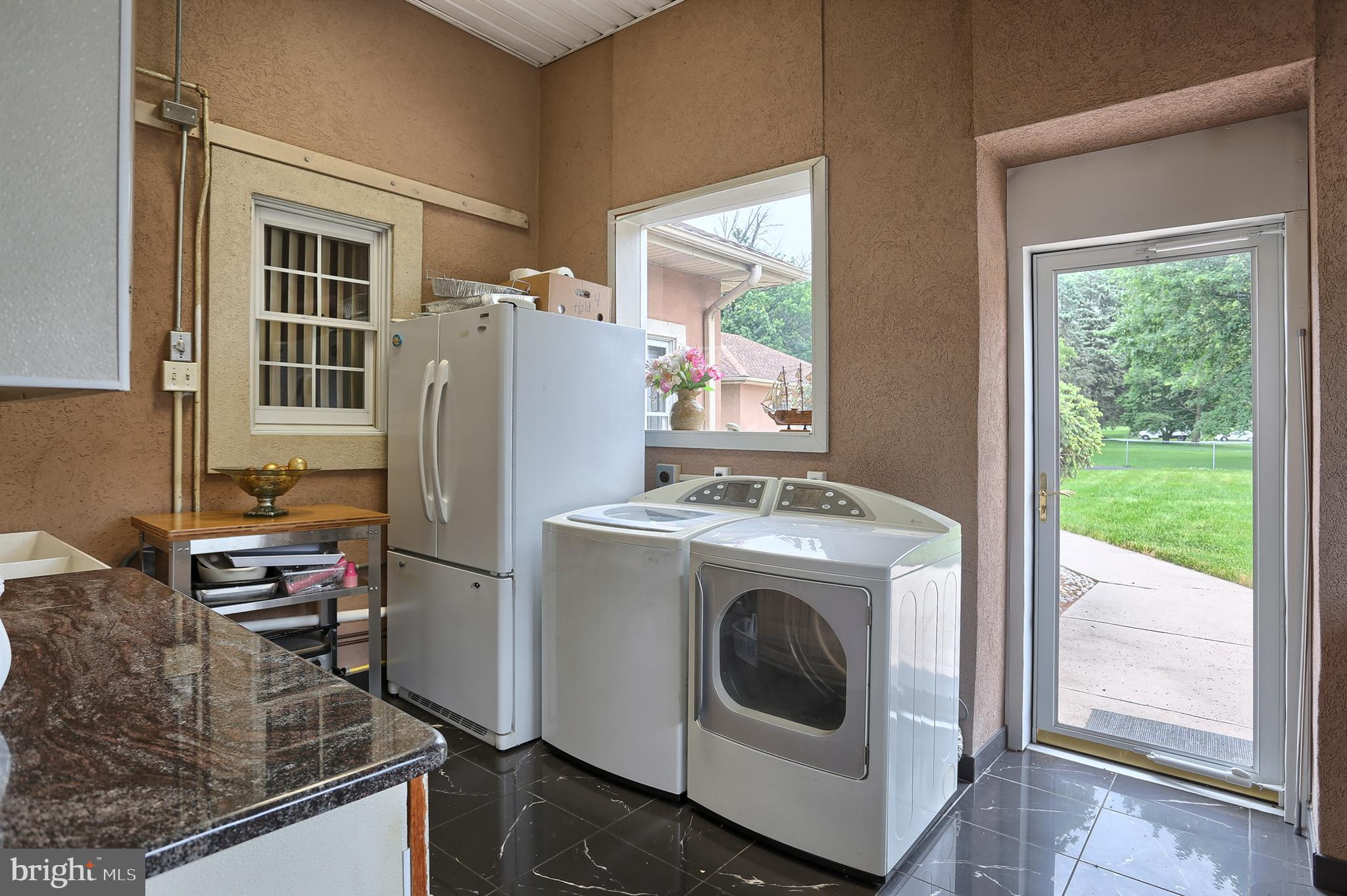 granite floors and counter tops and extra laundry