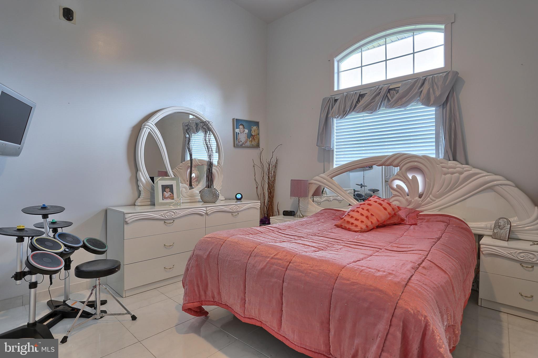 14' x 12' bedroom # 5 with porcelain tile floor