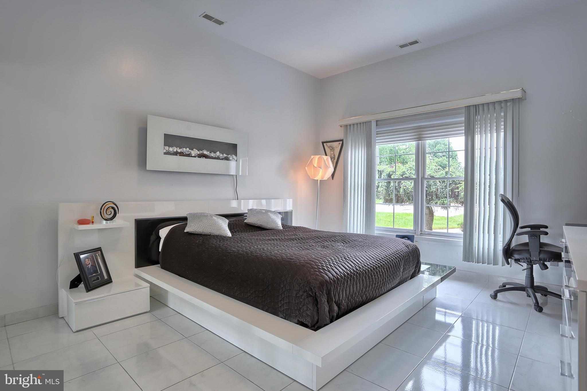 12' x 16' bedroom # 2 with porcelain floor and WIC