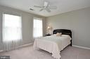 3rd upstairs bedroom with ceiling fan / new carpet - 42324 BIG SPRINGS CT, LEESBURG