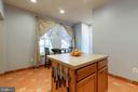 Kitchen with Island and Pantry - 9413 PRIMROSE LN, MANASSAS PARK