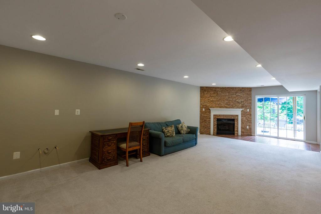 Recreation Room with Fireplace - 9413 PRIMROSE LN, MANASSAS PARK