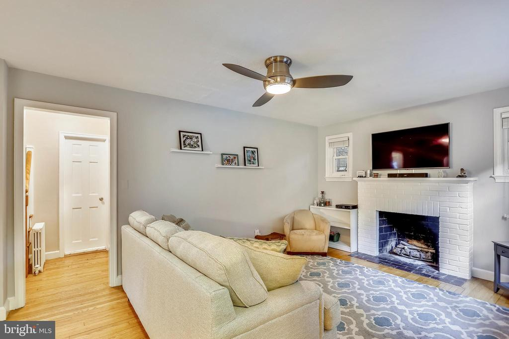 Wood burning fireplace is flanked by side windows - 2418 HURST ST, FALLS CHURCH