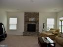 Family Room with stone fireplace - 42483 MADTURKEY RUN PL, CHANTILLY