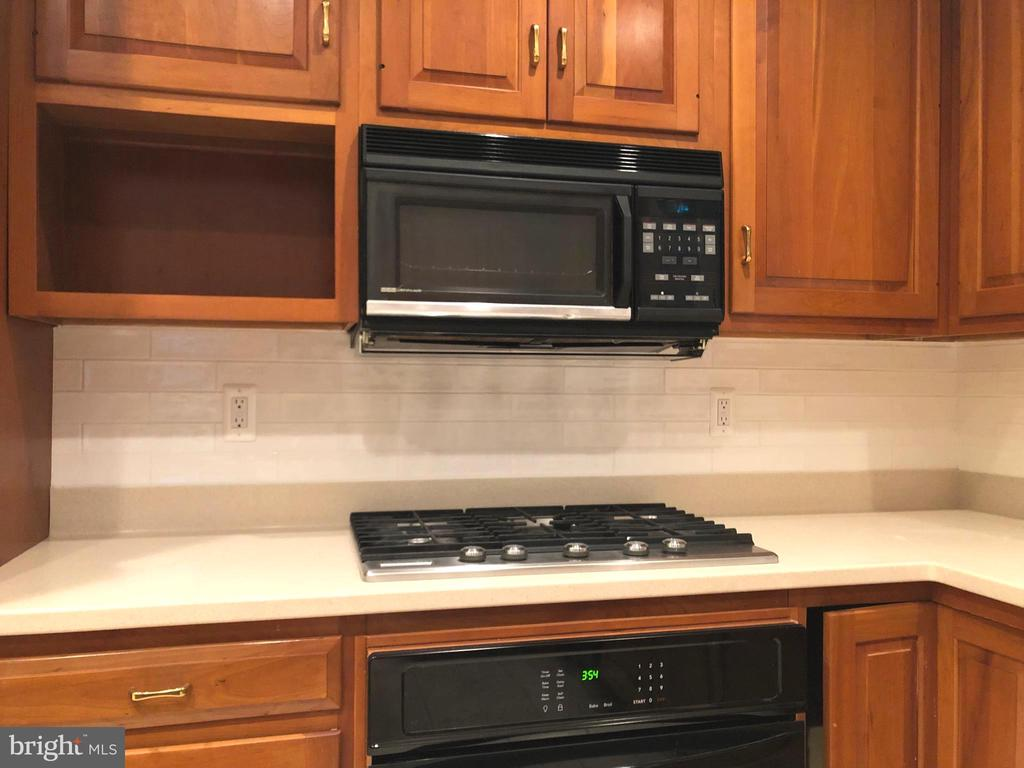 Just installed white subway tiles and new oven - 2405 SAGARMAL CT, DUNN LORING