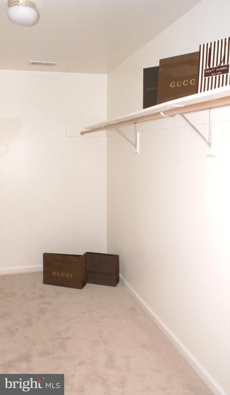 Her walk-in closet - 12809 SHADOW OAK LN, FAIRFAX