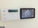 ADT alarm system & two web enabled thermostats - 12302 HUNGERFORD MANOR CT, MONROVIA