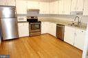 Kitchen with granite and stainless appliances - 2114 GREEN WATCH WAY #301, RESTON