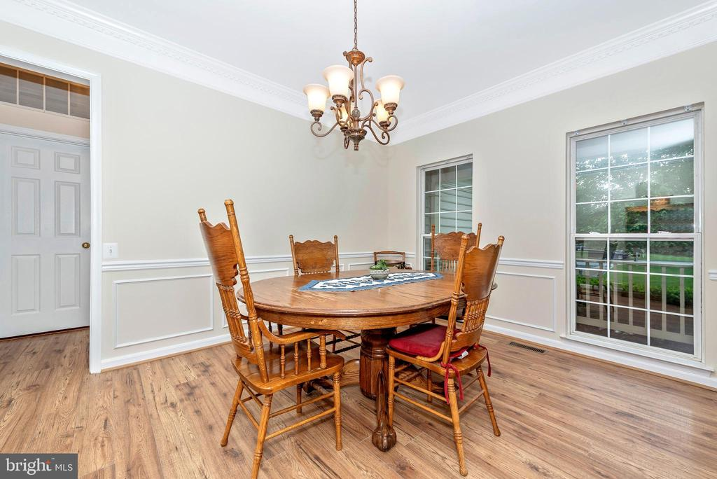 Dining Room has crown molding and new floors. - 1706 DEARBOUGHT CT, FREDERICK
