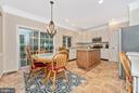 Eat-in Kitchen and doors to deck. - 1706 DEARBOUGHT CT, FREDERICK