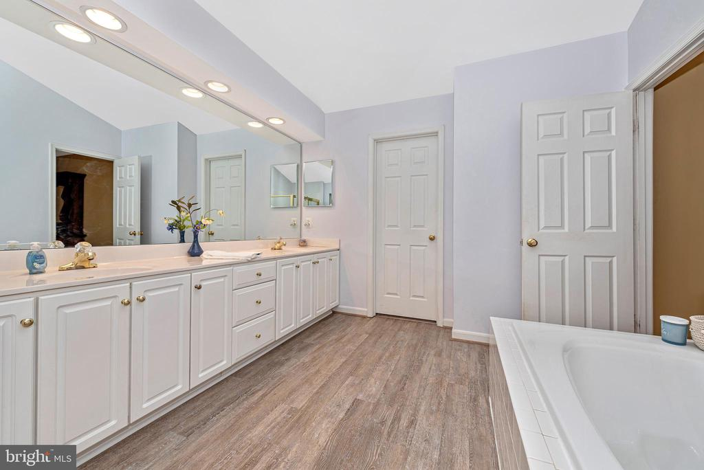 Large master closet opens off of this bath. - 1706 DEARBOUGHT CT, FREDERICK