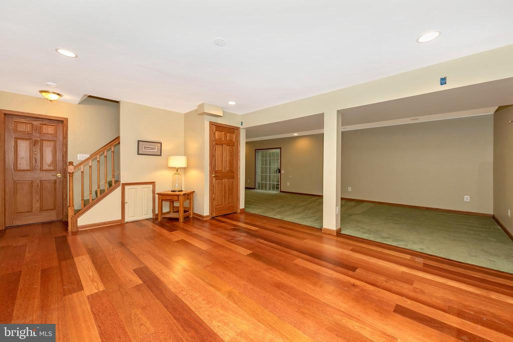 Basement with outside stairs up to backyard. - 1706 DEARBOUGHT CT, FREDERICK