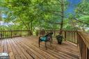 Views of yard and common area beyond. - 1706 DEARBOUGHT CT, FREDERICK