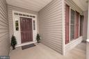 Welcoming covered front porch - 1400 LAKEVIEW PKWY, LOCUST GROVE
