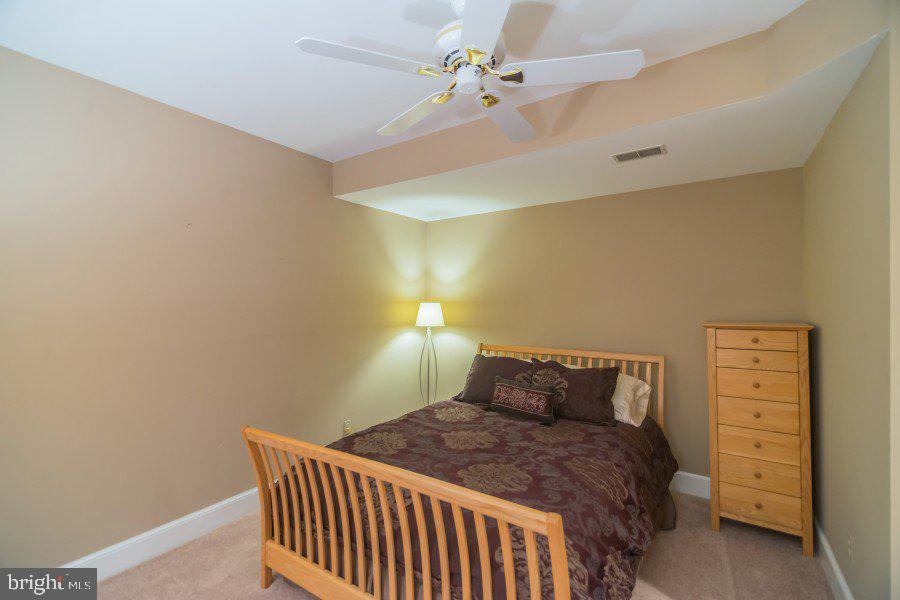 Lower level bedroom with full size window - 12009 BENNETT FARMS CT, OAK HILL