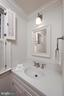 A quaint half bath is located just off the kitchen - 639 S SAINT ASAPH ST, ALEXANDRIA