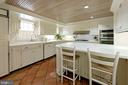 The sunny kitchen offers a bead-board ceiling - 639 S SAINT ASAPH ST, ALEXANDRIA