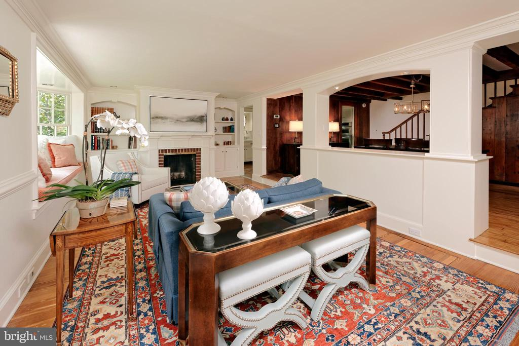 The spacious family room is warmed by a WB FP - 639 S SAINT ASAPH ST, ALEXANDRIA