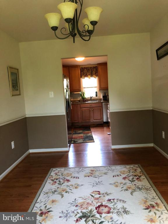 Dining Room with wood floors. - 15020 ROLLING RIDGE RD, HAYMARKET
