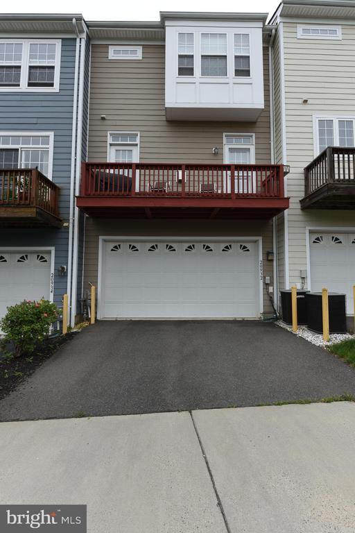 Two car garage and view of rear deck - 20932 HOUSEMAN TER, ASHBURN