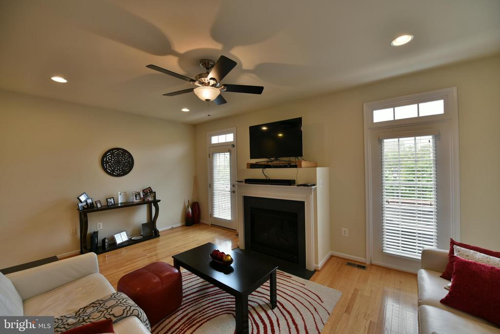Fireplace and Deck entrance from Living Room - 20932 HOUSEMAN TER, ASHBURN