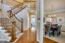 Two story foyer with curved solid oak staircase - 206 ROSE PETAL WAY, ROCKVILLE
