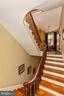 Restored, curved, extra wide staircase - 118 E CHURCH ST, FREDERICK
