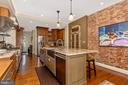 Beautiful brick accent wall - 118 E CHURCH ST, FREDERICK
