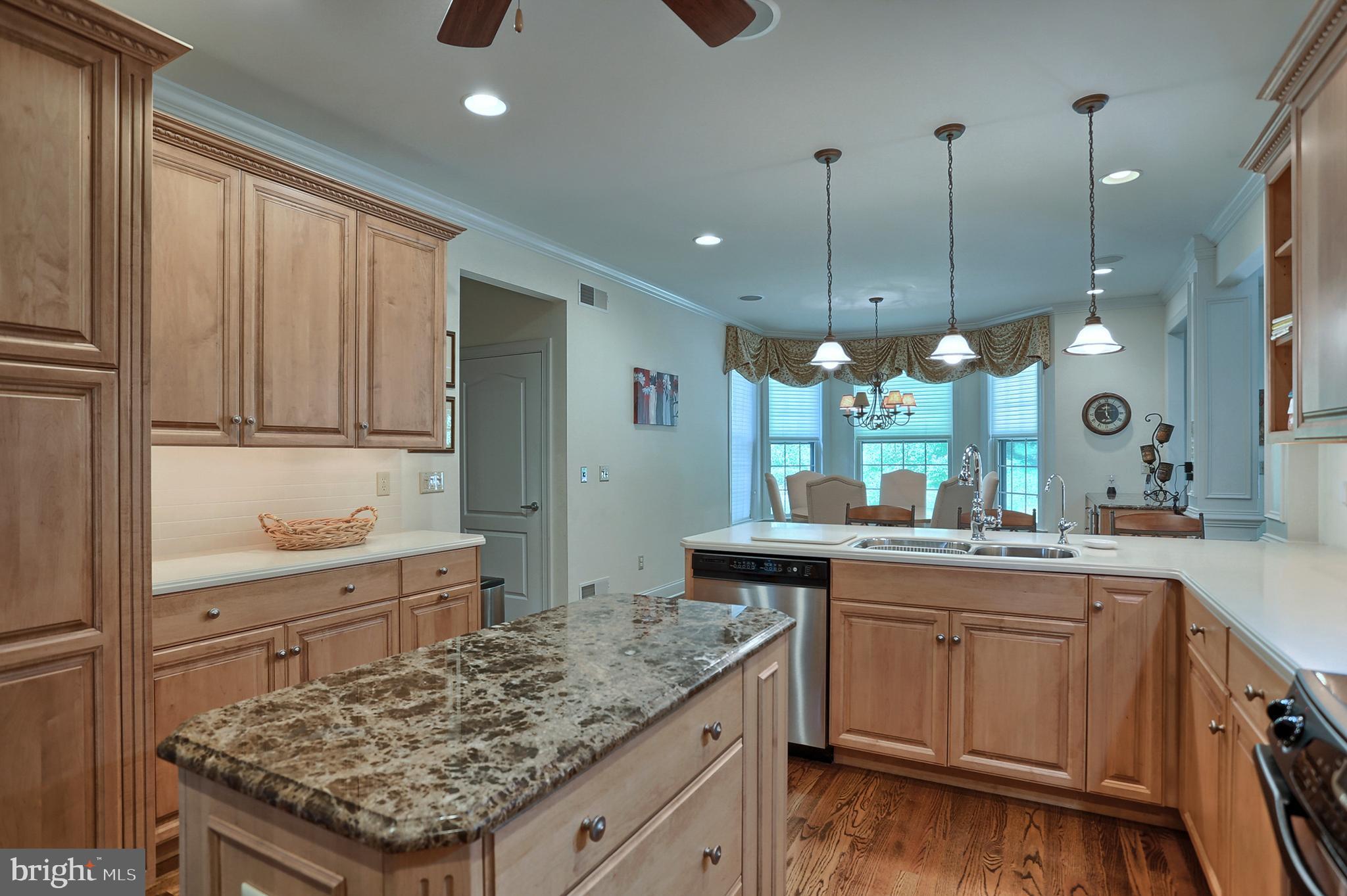 Another kitchen view toward breakfast area