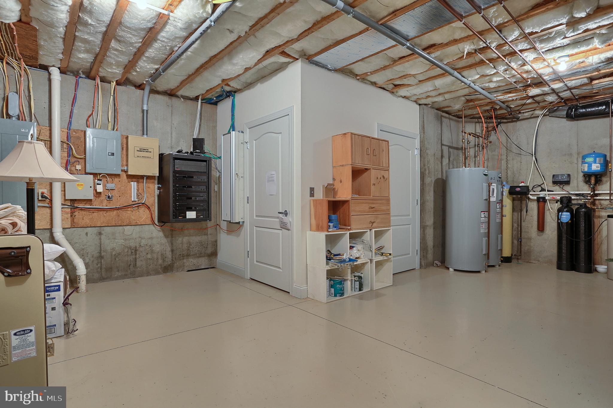 Utility/ Storage area with 3 floor elevator access