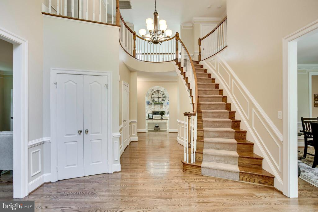 Grand two-story foyer with curved staircase - 1298 STAMFORD WAY, RESTON