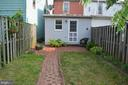 Brick patio and pathway in back yard - 235 W 5TH ST, FREDERICK