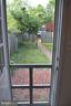 Screen door off main level den to back yard - 235 W 5TH ST, FREDERICK