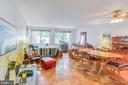 Expansive living & dining room with large windows - 5406 CONNECTICUT AVE NW #401, WASHINGTON