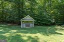 Shed with side garage door - 40947 GRENATA PRESERVE PL, LEESBURG