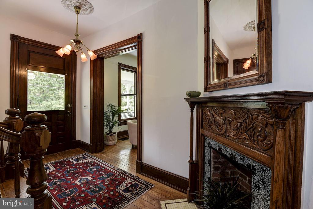 Elegant entry foyer with carved mantel fireplace - 11019 KENILWORTH AVE, GARRETT PARK