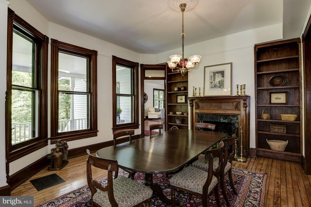 Dining room with fireplace and built-in cabinetry - 11019 KENILWORTH AVE, GARRETT PARK