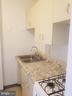 Kitchen with gas range - 1121 ARLINGTON BLVD #405, ARLINGTON