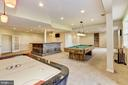 Basement has multiple game tables that convey - 8823 BARN OWL CT, GAINESVILLE