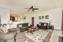 Large family room with fireplace overlooking yard - 8823 BARN OWL CT, GAINESVILLE