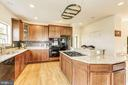 Gourmet kitchen with double wall ovens and island - 8823 BARN OWL CT, GAINESVILLE
