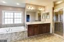 Master bath has dual sinks, soaking tub and shower - 8823 BARN OWL CT, GAINESVILLE