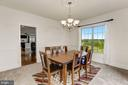 Formal dining room overlooking views. - 8823 BARN OWL CT, GAINESVILLE