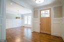 Gleaming wood foyer floors extend through 2 levels - 2320 N VERNON ST, ARLINGTON