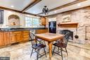 Kitchen with wood burning fireplace - 9587 BRONTE DR, BURKE