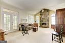 Family Room with Beautiful Stone Fireplace - 21099 RAINTREE CT, ASHBURN