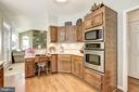 Kitchen Opens to Family Room - 21099 RAINTREE CT, ASHBURN