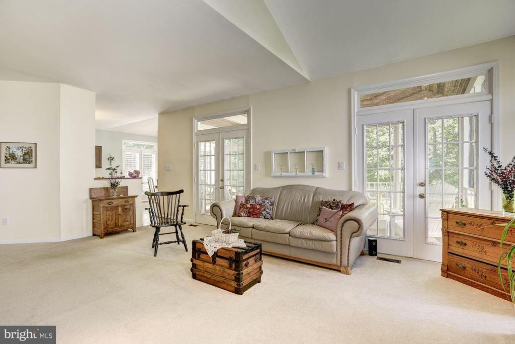 Family Room French Doors Open to Screened in Porch - 21099 RAINTREE CT, ASHBURN