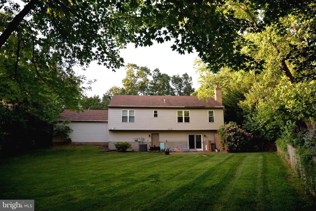 Back side with large flat yard - 11827 BROCKMAN LN, GREAT FALLS