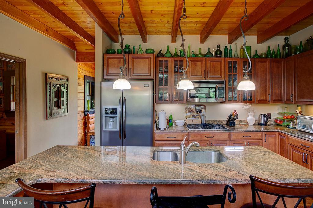 Island seating in the kitchen - 34876 PAXSON RD, ROUND HILL